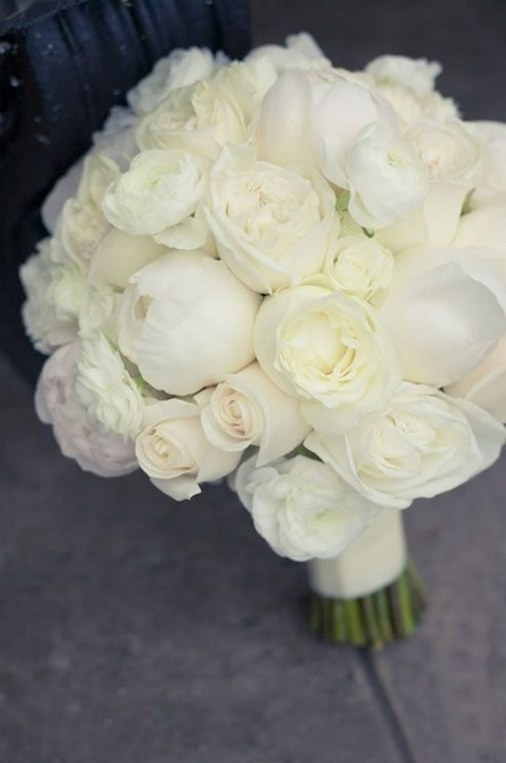 pure-white-bouquet-features-fresh-roses-peonies-and-ranunculuses